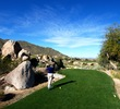 Many tee box locations at the SunRidge Canyon golf course feature large boulders beside them.