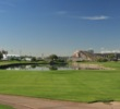 The ninth and 18th holes at the ASU Karsten Golf Course mirror each other on alternate sides of a large, skinny pond.