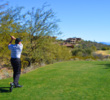SunRidge Canyon owner Don Misheff, who plays near scratch, tees off on the fifth hole.