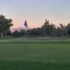 A sunset view of a green from Tres Rios Golf Course at Estrella Mountain Park.