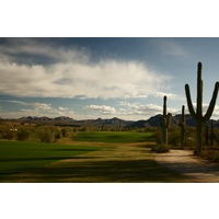 The seventh hole on We-Ko-Pa Golf Club's Saguaro Course is a par 4 that plays to a crowned green.