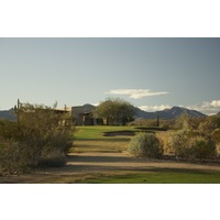 The par-3 ninth hole on the Saguaro Course at We-Ko-Pa Golf Club is a short 137-yard shot.