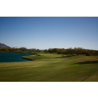 The eighth hole at the Golf Club at Vistoso is a par 4 that wraps around water.
