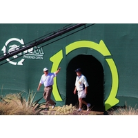 "Billy Mayfair waves to the crowd upon entering the ""stadium"" at the 16th hole during the 2012 Waste Management Phoenix Open."