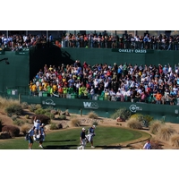 Players who interact with the crowd -- like Billy Mayfair here -- get fans roaring at the 16th hole during the Waste Management Phoenix Open.