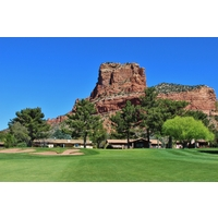 The red rocks of Sedona tower over the 11th green at Oakcreek Country Club in Sedona, Arizona.