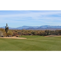 The fourth fairway on the Cholla Course at We-Ko-Pa Golf Club falls downhill after a hill crests in the landing zone.