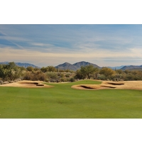 Bunkers ring the ninth green on the Cholla Course at We-Ko-Pa Golf Club in Fort McDowell, Arizona.