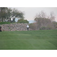 Coyote Lakes Golf Club - Phoenix Scottsdale - Golfer staring at stone wall on No. 6.