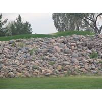 Coyote Lakes Golf Club - Phoenix Scottsdale - Hole No. 6, stone wall towers to seven feet